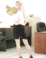 Blonde office worker Olivia Fox stripping off blouse and skirt to pose naked