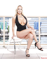 Busty blond Olivia Fox modeling naked outdoors on bench after swimsuit removal