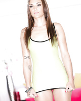 Hot babe Olivia Wilder posing in see thru dress, thong panties and heels