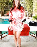 Brunette babe Olivia Wilder stripping off lingerie beside massage table