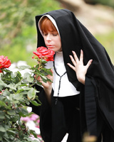 Redheaded nun Penny Pax shows off her big natural boobs and and twat