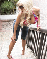 Blonde MILF Puma Swede pleasures a guy with her feet after rolling an ankle