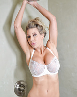 Busty blonde Puma Swede gets naked, soapy and naughty in the shower,