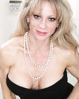 Older blonde woman Christina Brim stripping naked for masturbation session