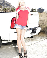 Blonde Rikki Six poses outdoors and takes off her white panties