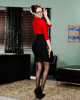 Leggy white chick Riley Reid strips to black stockings with her glasses on