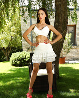 First timer Sasha Rose slides a dildo up her wet pussy on chair under a tree
