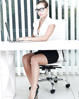 Nerdy secretary Satin Bloom undressing to masturbate with sex toy on desk