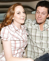Redhead cutie Scarlett Fay reveals her tits and gives a blowjob in the car