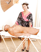 Hot Asian beauty Sharon Lee gives some erotic massage and blows a big cock