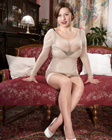 Classy lady Sheridan Love unveils her knockers prior to removing her pantyhose