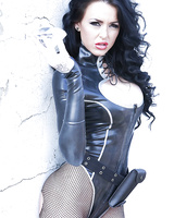 Hot babe in latex outfit Stacey Lacey uncovering her big round tits