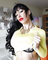 Buxom brunette model Suhaila Hard exposing big knockers and pierced nipples