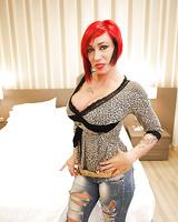 Busty redhead Suhaila Hard shows off huge knockers and pierced nipple