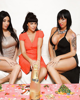 Three top-heavy brunette vixens slowly uncovering their goods