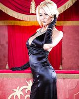 Tremendous milf Tia Layne is posing in her fascinating dress