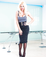 Fully clothed platinum blonde secretary with big juggs posing in pantyhose