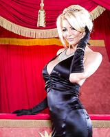 Blonde milf Tia Layne is showing off in her wonderful black dress