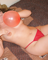 Hot babe plays with balloon
