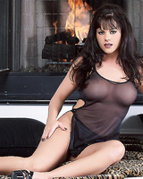 Jewel Denyle strips her sexy dress and fingers her cunt.