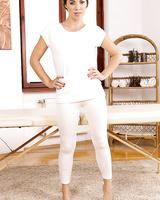 Long legged beauty Tiffany Doll peels yoga pants to finger & flaunt bare feet