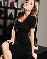 Busty MILF Veronica Avluv strips down to her provocative lingerie at work