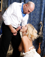 Hot MILF Vittoria Risi gets down on her knees to blow a large cock