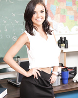 Busty dark haired teacher Dillion Harper stripping in the classroom