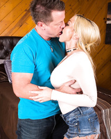 Blonde MILF Christie Stevens with big tits makes it with guy on sofa