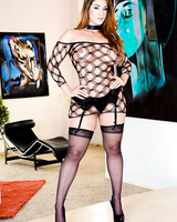 Latin solo model Miss Raquel removes mesh dress while posing in high heels