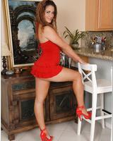 Latina wife Miss Raquel revealing her round butt from red miniskirt