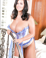 Buxom pornstar Sarah Nicola Randall letting corset fall to expose big juggs