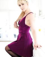 Beautiful blonde MILF flaunts hot ass wearing black stockings & garter