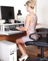 Hot blonde secretary Cherie Deville hikes skirt to toy with pen at her desk