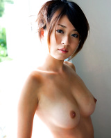Japanese babe Risa Misaki strikes great nude and non nude solo poses