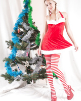 Young Alecia Fox in pigtails showing tiny titties & toying by the Xmas tree