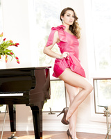 Alluring teen babe Dani Daniels peels off her pink dress and rides dildo