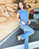 Playful blue-eyed girl Dani FTV pulls off her blue jeans and panties outside