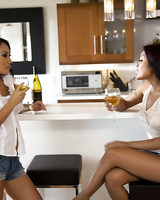 Busty lesbians Asa Akira and Kaylani Lei are in the kitchen packing each other with toy