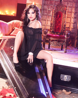 Beautiful Asian milf Kaylani Lei shows the naked beauty of her incredible body