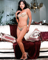 Lewd Asian babe Kaylani Lei is frisky enough to pose in white lingerie and press small tits.