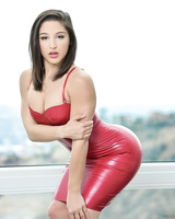 Abella Danger toys her perfect booty in sexy red dress and high heels