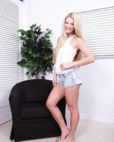 Teen babe Addison Avery pulling down denim shorts to bare perfect ass