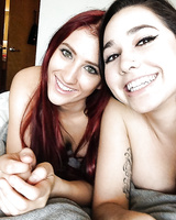 Teen lesbians Addison Ryder and Karlee Grey taking selfies while kissing