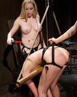 2 lesbians fuck a restrained girl with electro dildos in a dungeon