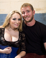 Dominatrix Aiden Starr wears stockings while humiliating her slave
