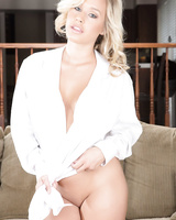 Schoolgirl Kennedy Leigh takes off a man's white shirt to model in the nude