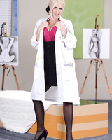 Seductive doctor Ashley Fires gets completely naked while alone in the office