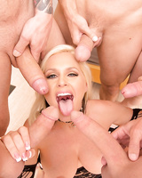 Hot blonde female Alena Croft is surrounded by big cocks to suck on