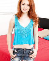 Redhead amateur Alice Green exposes her clit after doffing shorts
